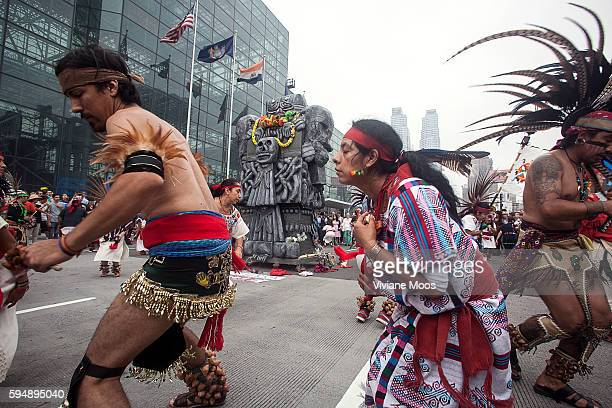 New York Mexica Aztec Indians from central Mexico dancing around the statue of Mother Earth Goddess during the march It's being called the largest...