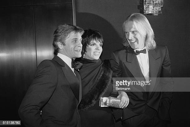 Mikhail Baryshnikov Liza Minnelli and Alexander Godunov pose at the Metropolitan Opera House following the opening of an eight week season of the...