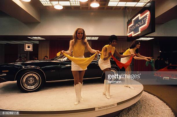 Models go through their act at the Chevrolet Camaro exhibit at the International Automobile Show in the Coliseum
