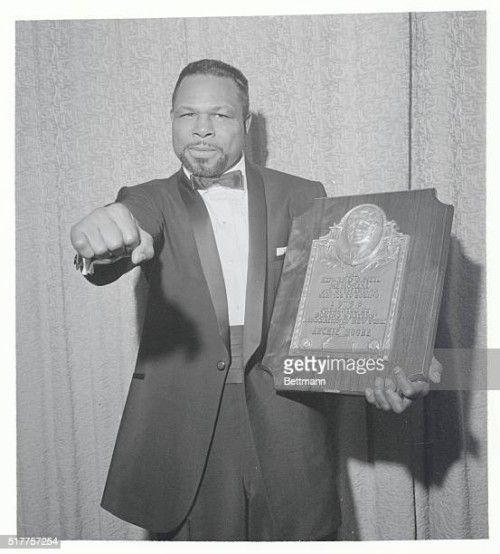 Moore Honored Boxer Archie Moore displays the powerful right that helped earn him the Edward J Neil Plaque presented to him at the Boxing Writer's...