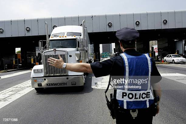 A New York New Jersey Port Authority policeman stops a truck driver to check the cargo passing through the east bound New Jersey entrance and toll...
