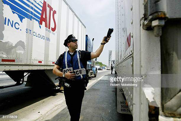 A New York New Jersey Port Authority policeman uses a radiation detector to check a tractor trailer passing through the east bound New Jersey...