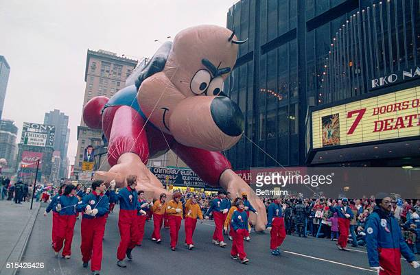 A giant balloon of cartoon character Underdog travels along Broadway in the Macy's Thanksgiving Day Parade in New York City