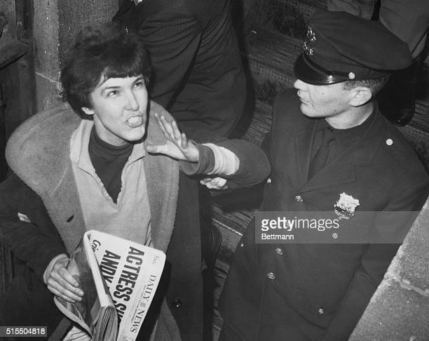 Actressplaywright Valerie Solonas shouts back at crowd 6/4 as she is escorted into police headquarters She was arraigned for attempted murder and...