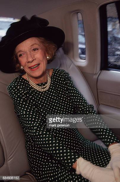Brooke Astor in her limousine while going to construction site for housing and homeless