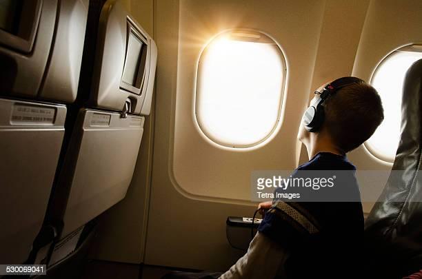 USA, New York, New York City, Boy (6-7) in plane