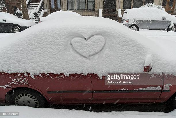 USA, New York, New York City, Brooklyn, Heart shape in snow on car