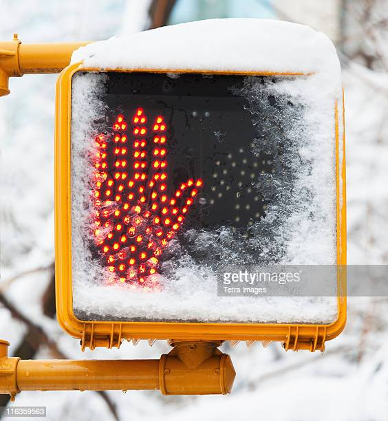 """usa, new york, new york city, close up of """"""""don't walk sign"""""""" with glowing red hand in winter - walk don't walk signal stock pictures, royalty-free photos & images"""
