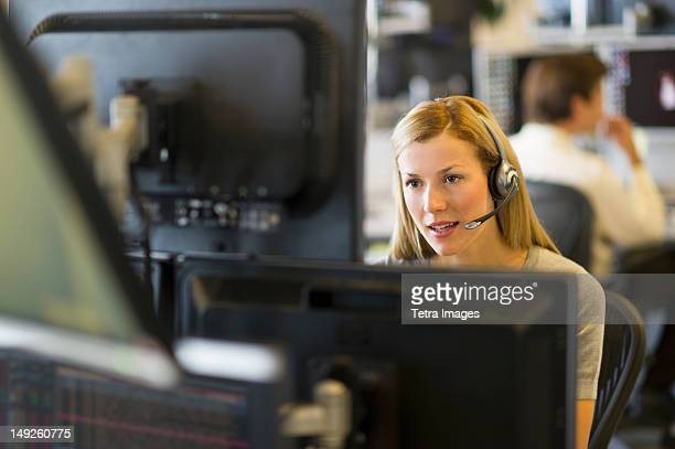 USA, New York, New York City, Female trader at trading desk