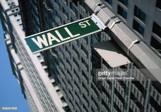 USA, New York, New York City, Lower Manhattan, 'Wall St' street sign,