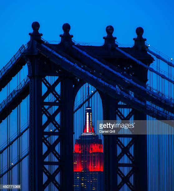 USA, New York, New York City, Manhattan, Williamsburg Bridge in front of Empire State Building at night