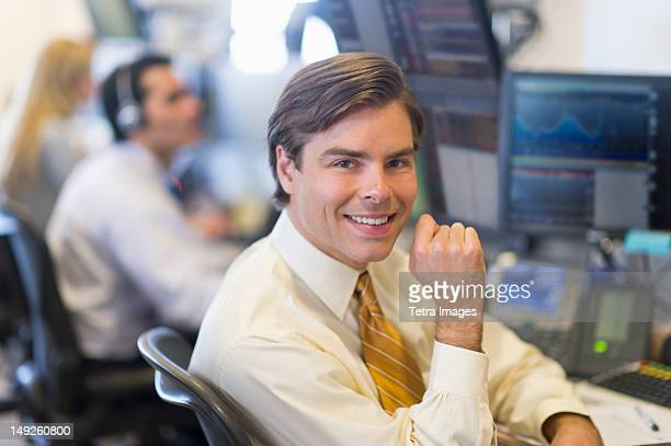 usa, new york, new york city, portrait of male trader at trading desk - trading floor stock pictures, royalty-free photos & images