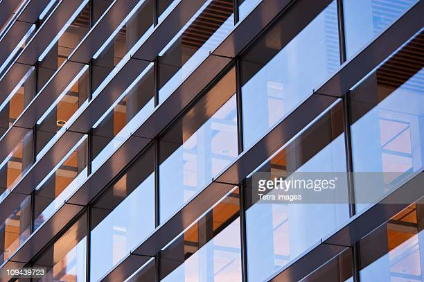 USA, New York, New York City, Reflections in windows of office block