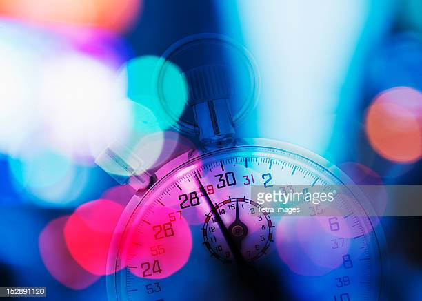 USA, New York, New York City, Stopwatch and colorful lights