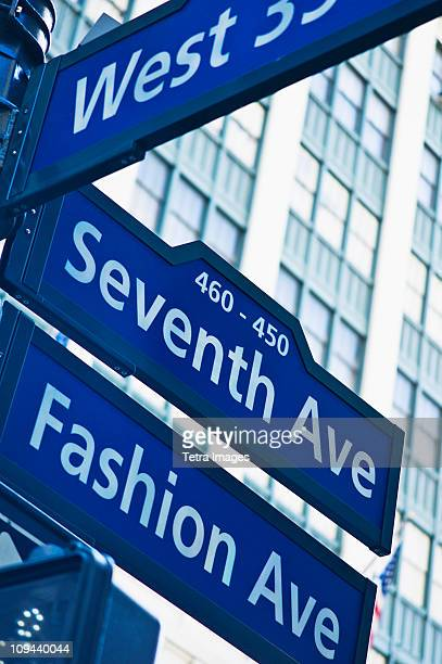 usa, new york, new york city, street sign for fashion avenue and seventh avenue in manhattan - 7th avenue stock pictures, royalty-free photos & images