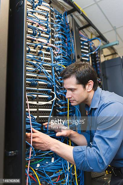 USA, New York, New York City, Technician inspecting network server