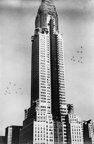 Tower Of The Chrysler Building Being Under Construction On Right And Left Are
