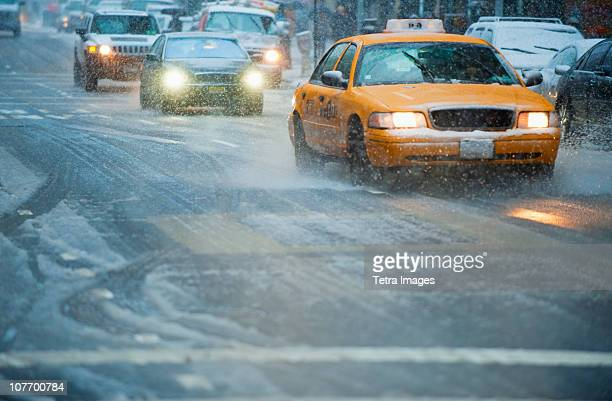 usa, new york, new york city, traffic on street in snow - slush stock photos and pictures
