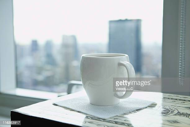 USA, New York, New York City, White cup on desk in office