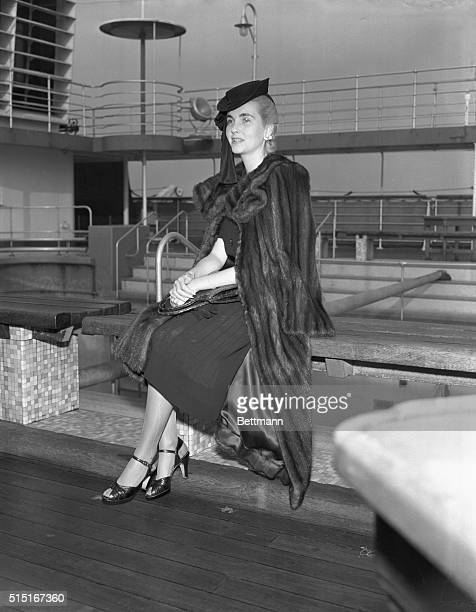 Countess Babs Back Countess Barbara Hutton HaugwitzReventlow answering questions of reporters aboard the S S Conte Di Savoia on arrival here Oct 21...