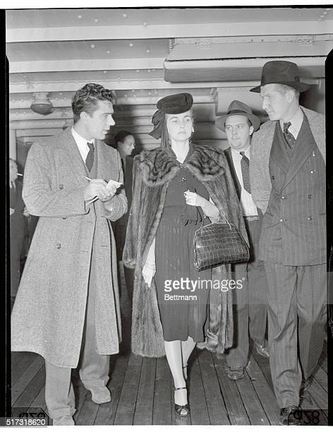 """New York, New York: Countess """"Babs"""" Back. Countess Barbara Hutton Haugwitz-Reventlow, answering questions of reporters aboard the S. S. Conte Di..."""