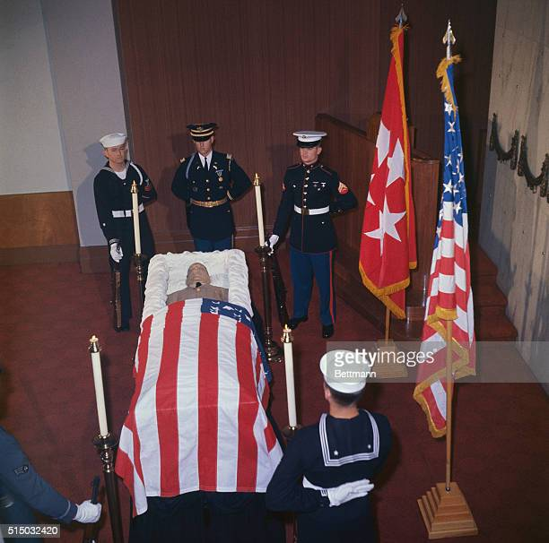 Dressed in tropical suntans General of the Army Douglas MacArthur lies in repose at the Universal Funeral Chapel Lexington Avenue and 52nd Street The...