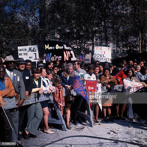 Eager fans carrying signs and banners await the arrival of the New York Mets World series visitors at Bryant Park at 42nd Street here October 20th...