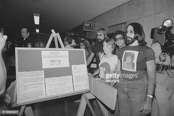 Fans of the late John Lennon stand in corridor outside courtroom in Manhattan August 24 where State Supreme Court Justice Dennis Edwards sentenced...