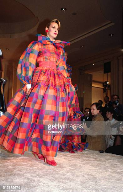 Fashion model Jerry Hall wears a bright plaid gown for Bill Blass' Spring collection show