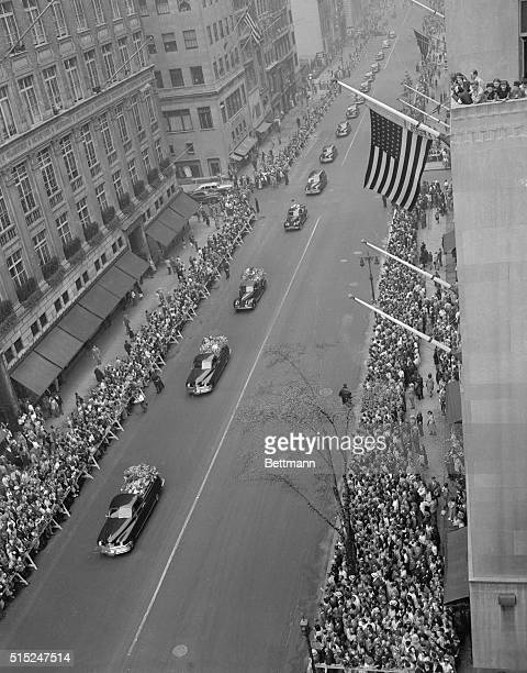 General scene of funeral cortege coming up 5th Ave to St Patrick's cathedral Crowds lined up on both sides Flower cars precede hearse carrying Babe's...