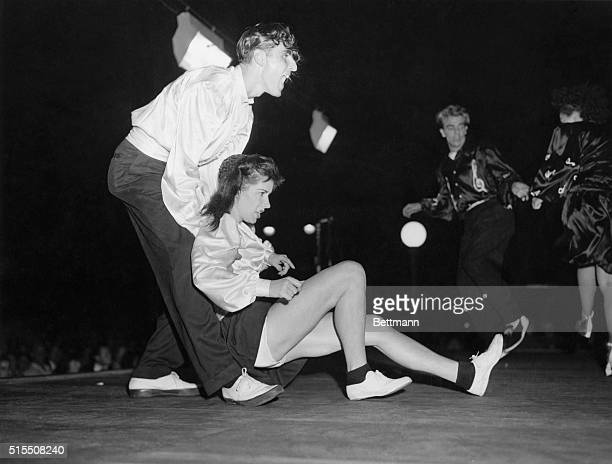 Harvest Dance Contest held on the Mall in central Park New York Photo shows Tommy Langella and Peggy Hutton of the Bronx jitterbugging They won first...