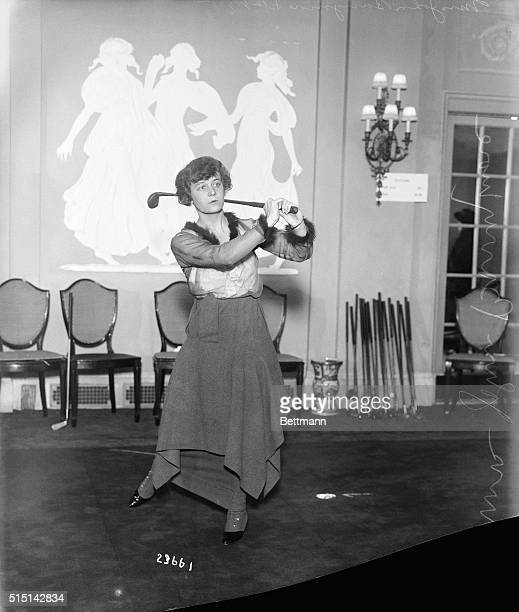 Mrs. John Barrymore golfing at the indoor course at the Waldorf Astoria Hotel.