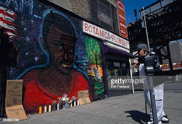 Mural of Amadou Diallo who was shot dead by the NYPD Four NYPD officers were painted as KKK members but this was painted over black by vandals