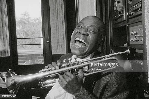 Satchmo's Back Louis Satchmo Armstrong gives his great big famous grin back home in Queens New York after 10 weeks of hospitalization Armstrong...