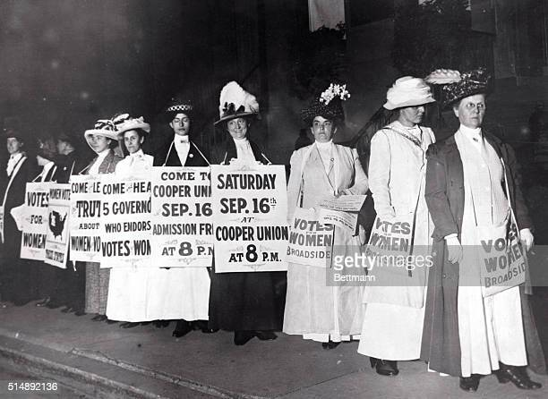 New York Society Woman Suffragettes as sandwich men advertise a mass meeting to be addressed by the Governor of the Suffrage states Photograph