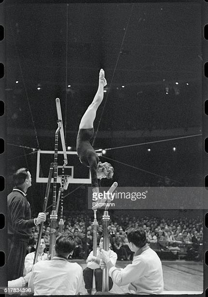 Soviet gymnast Larisa Latynina shows gymnastic prowess at Madison Square Garden Here she is on the uneven bars