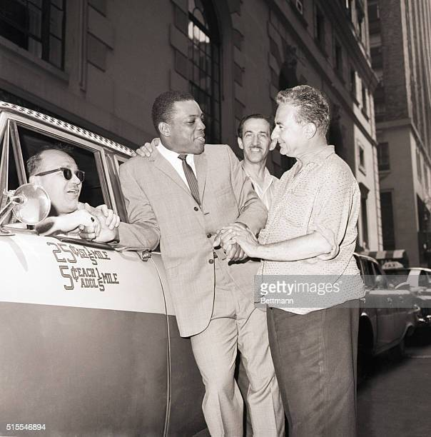 New York, New York- Willie Mays being greeted warmly by cab drivers in front of the Roosevelt Hotel. Left to right; Rudolph Anderson, Willie, Harry...