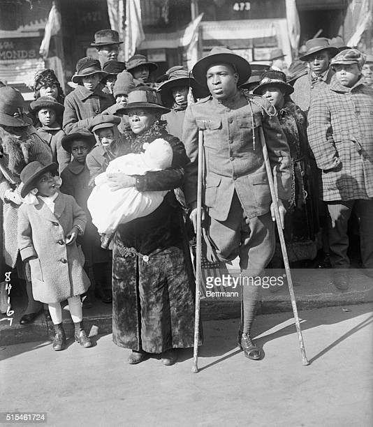 Wounded black soldier viewing parade of the 369th colored infantry