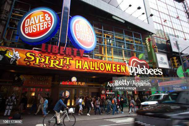 new york, ny: 42nd street scene near times square - dave & buster's stock pictures, royalty-free photos & images