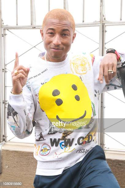 Pharrell Williams visits the Empire State Building in support of The Yellow Ball on September 10 2018 in New York NY