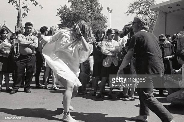 Couple of hippies dance to the music of the Grateful Dead at a concert in Tompkins Square Park in the East Village in Manhattan on June 1, 1967.