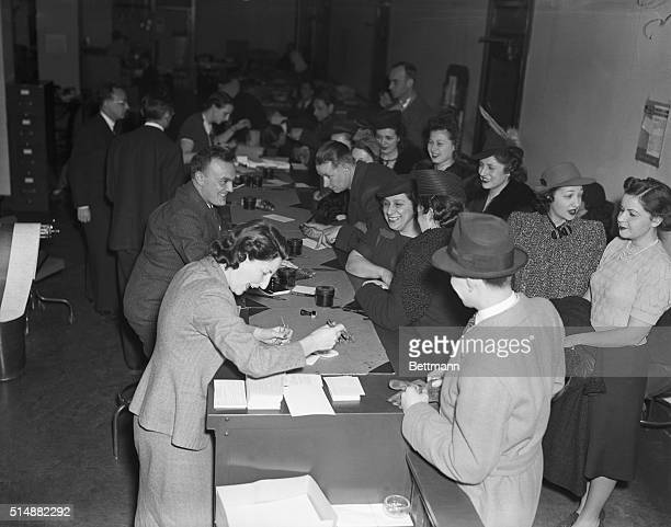 New York, NY: A view of the branch office at where applications for the first benefits of the Social Security Act are being taken. More than 80,000...