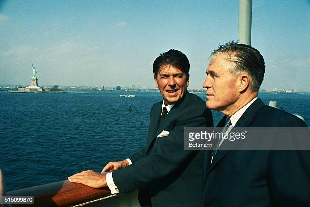 Aboard the SS Independence California governor Ronald Reagan and Michigan Governor Ronald Reagan and Michigan Governor George Romney stand at rail...