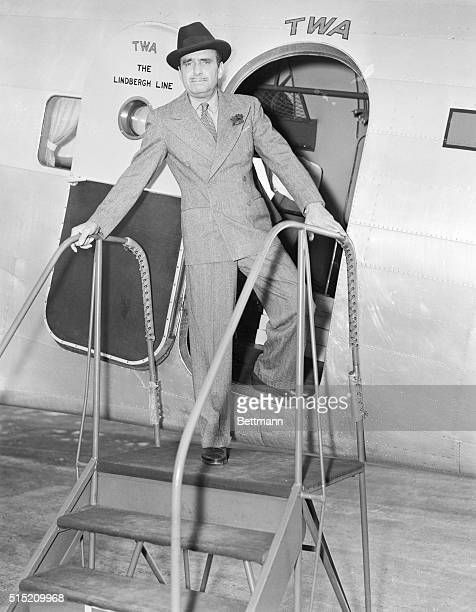 New York, NY: Accompanied by his secretary Chuck Lewis, the dashing Doug Fairbanks , with a red a carnation in his buttonhole, boarded the TWA...