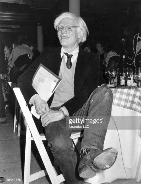 Andy Warhol shows off his cowboy boots at a Western Wear party at Bloomingdale's in Manhattan on August 3 1979 The party was a fundraiser for the JFK...