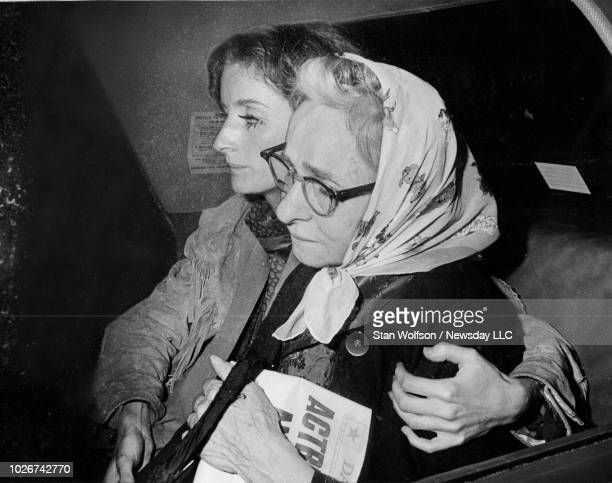 Andy Warhol's mother Julia Warhola is comforted inside a taxicab by actress Viva as the pair leave Columbus Hospital in Manhattan on June 3 1968...