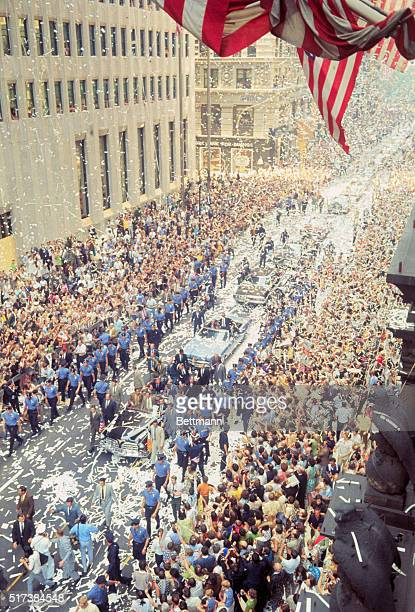 Apollo 11astronauts Michael Collins Buzz Aldrin and Neil Armstrong ride in open car up Lower Broadway toward City Hall for reception The air is thick...