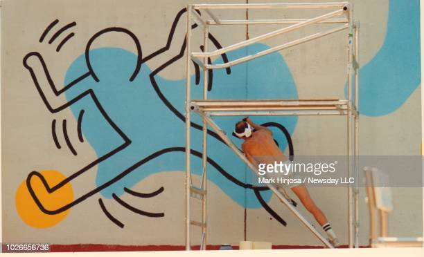 Artist Keith Haring paints a mural on a 150ft wall at Clarkson St and Seventh Ave in Manhattan on August 20 1987
