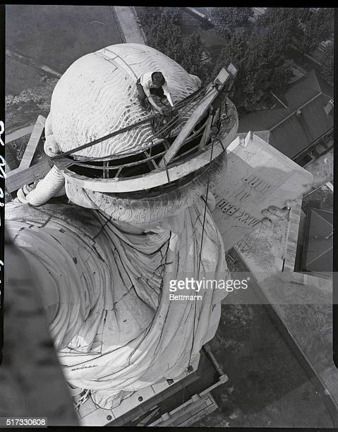 7/27/1938 New York NY At the left is a photo of the head of the Statue of Liberty showing her despiked crown The department of the interior through...