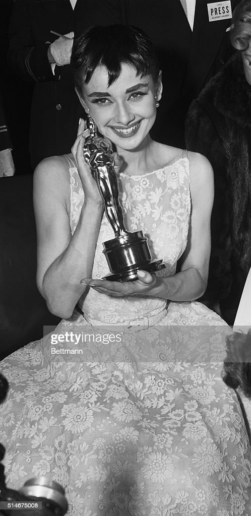 Audrey Hepburn Holding Oscar : News Photo